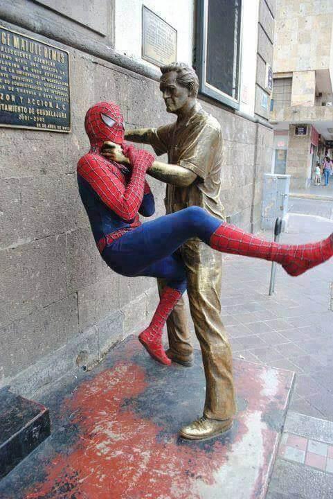 Statue grabbing Spider man's Neck
