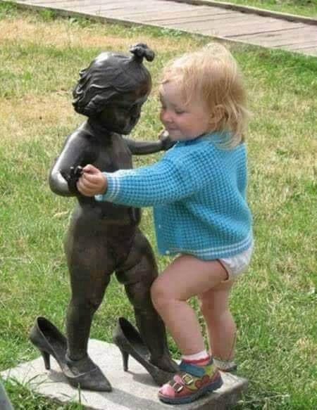 Kid dance with Funny Statue